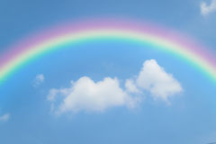 Blue sky with rainbow. Nature cloudscape with blue sky and white cloud with rainbow Royalty Free Stock Photo