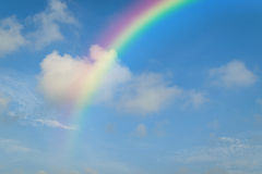 Blue sky with rainbow. Nature cloudscape with blue sky and white cloud with rainbow Royalty Free Stock Images