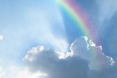 Blue sky with rainbow. Nature cloudscape with blue sky and white cloud with rainbow Royalty Free Stock Photos