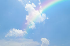 Blue sky with rainbow. Nature cloudscape with blue sky and white cloud with rainbow Stock Photo