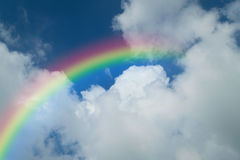Blue sky with rainbow. Nature cloudscape with blue sky and white cloud with rainbow Stock Photos