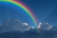 Blue sky with rainbow. Nature cloudscape with blue sky and white cloud with rainbow Royalty Free Stock Image