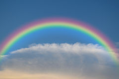 Blue sky with rainbow. Nature cloudscape with blue sky and white cloud with rainbow Stock Photography