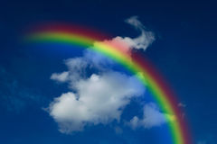 Blue sky with rainbow. Nature cloudscape with blue sky and white cloud with rainbow Royalty Free Stock Photography