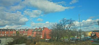 Blue sky red brick town royalty free stock photos