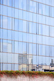 Blue sky reflected in the glass building wall Royalty Free Stock Photo