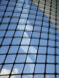 Blue sky reflected on office building glass Royalty Free Stock Photography