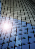 Blue sky reflected on office building glass Royalty Free Stock Photos