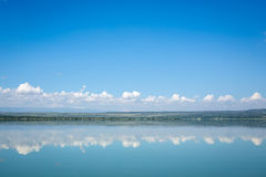 Blue sky reflected in waters of Elmenteita Lake, Kenya Stock Photography