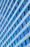 Blue Sky Reflected in Windows of a Skyscraper Royalty Free Stock Photography
