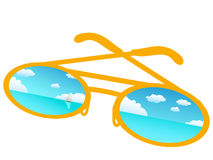 Blue sky reflecting in sunglasses Stock Photo