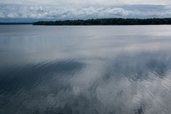 Blue sky reflecting in water. Beautiful blue sky with clouds reflecting in water. Nice background. Shot in Latvia Stock Photography