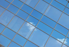 Blue sky reflecting on windows Royalty Free Stock Image