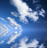 Blue sky reflection. Blue sky seascape with reflected clouds royalty free stock photography
