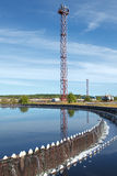 Blue sky reflection in sedimentation tank on treatment plant. Blue sky reflection in sedimentation settler on treatment plant. Water recycling Stock Image