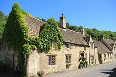 Small village Castle Combe in England in spring. Blue sky and the residential area in the small village Castle Combe in England on a sunny day in spring Royalty Free Stock Images