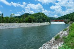 Check dam in Kio Lom Dam, Lampang Province Thailand. Blue sky and river,weir,Check dam in Kio Lom Dam, Lampang Province Thailand Stock Photography