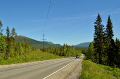 Blue sky .road.forest. The picture the road to Umba.summer Stock Photos