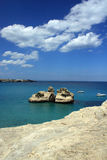 Blue sky and rocky coastline Royalty Free Stock Photos