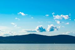 Blue Sky, rolling hills, and a small sail boat traversing the Hudson River in the distance, Sleepy Hollow, Upstate New stock photos