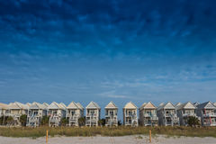 Blue Sky with a Row of Beach Homes Stock Photography