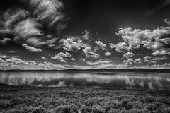 Blue Sky's Blue Water BW. Panoramic view of Strawberry Reservoir in Utah USA with still waters and a partly cloudy sky's in July. Look close you can see a royalty free stock photo