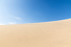 Blue sky and sand dunes. Sunny day. Royalty Free Stock Image