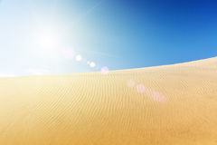 Blue sky and sand dunes. Sunny day. Royalty Free Stock Photography
