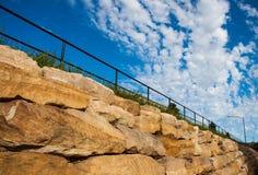 Blue sky with sand stones Stock Photos