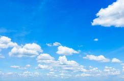 Blue sky with scattered clouds stock photography