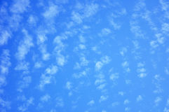 Blue sky with scattered clouds Stock Images