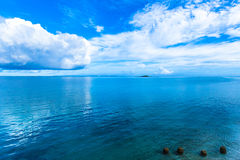 Blue sky, sea and four stones at Okinawa ocean Royalty Free Stock Images