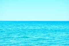 Blue sky and sea horizon. Blue sea water wit waves and clear skyscape with visible horizon. Vacation and summer concept. Copy space for text stock image