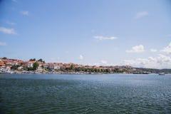 Blue sky sea town Stock Photos