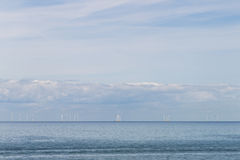 Blue sky, sea and wind turbines from Whitstable, Kent Royalty Free Stock Photos
