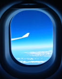 Blue sky seen from the airplane window Royalty Free Stock Photography