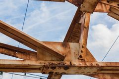 Blue sky seen through open rusted girders urban landscape. Horizontal aspect Stock Image