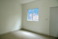 Blue sky seen through window of empty room white space. Stock Images
