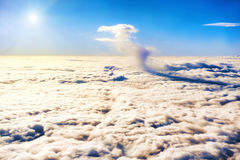 Blue sky, shining sun and clouds Stock Images