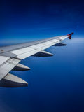 Blue sky. A shot of a wing of an airplane in the blue sky Stock Photography