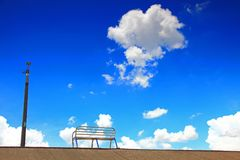 Blue sky and silent chair Stock Image