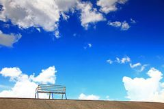 Blue sky and silent chair Stock Photo