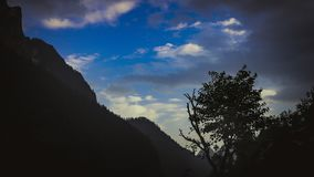 Blue sky and silhouette mountain stock photography
