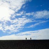 Blue sky. Silhouette of people walk on a horizon Royalty Free Stock Image