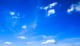 Blue sky with small clouds. Some small white clouds spreaded over a bright blue sky Royalty Free Stock Photography