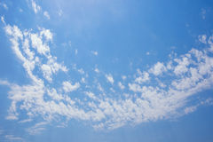 Blue sky with small white clouds. Blue sky with many small white clouds forming a curved strip Stock Images