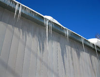 Blue sky, snow and icicles Stock Photo
