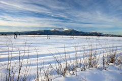 Blue sky and snowy rural scenic. Stock Photos