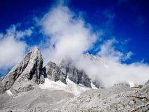 Blue sky, Snowy stone mountain. Deep blue sky above the Jade Dragon Snow Mountain, Yunnan, China Royalty Free Stock Photography
