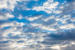 Blue sky with some clouds background texture stock photos